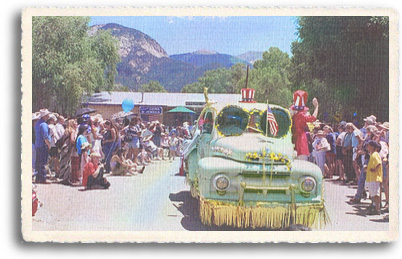 Locals and visitors line up along the main street through Arroyo Seco New Mexico for the annual July 4th parade.