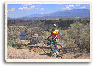 The Taos Mountains provide a stunning backdrop for this Taos area road ride, the end loop of the Enchanted Circle.